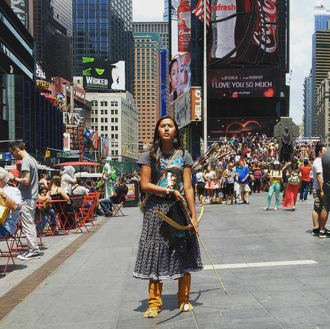 Naelyn Pike, a 16-year-old member of the Chiricahua Apache tribe, demonstrated in Times Square on Friday against a land swap between the federal government and a copper company that could affect land the protesters hold sacred. Photo credit: Standing Fox